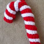 Free crochet pattern for a candy cane ornament.